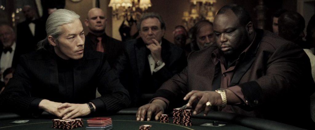 Китаец и афроамериканец за покерным столом
